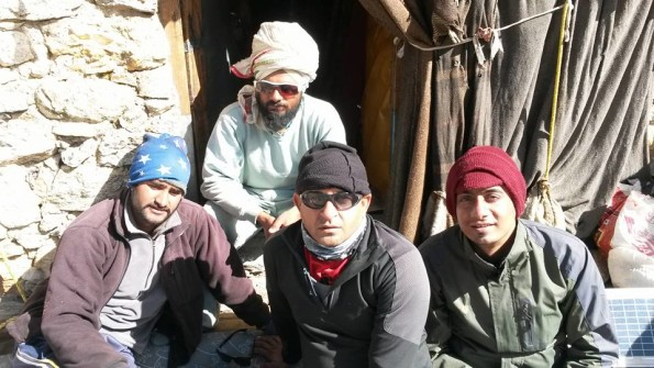 Starting from Left: Our porter Akhil, Manmohan and me with Mauni baba at the Back.